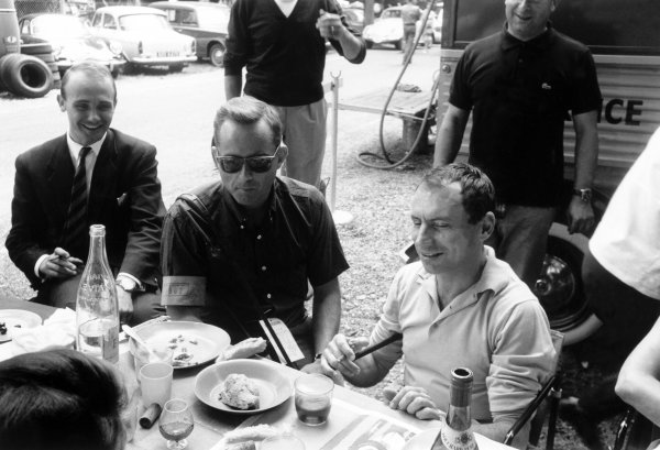 1962 French Grand Prix Rouen-les-Essarts, France. 6-8 July 1962 Ferrari drivers Phil Hill and Willy Mairesse at lunch. Portrait, paddock World Copyright: LAT PhotographicRef: Autosport b&w print. Published: 13/07/1962 p41