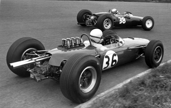 1965 Dutch Grand Prix.Zandvoort, Holland. 18 July 1965.Innes Ireland, Lotus 25-BRM, 10th position, leads Bob Anderson, Brabham BT11-Climax, retired, action.World Copyright: LAT PhotographicRef: Motor b&w print