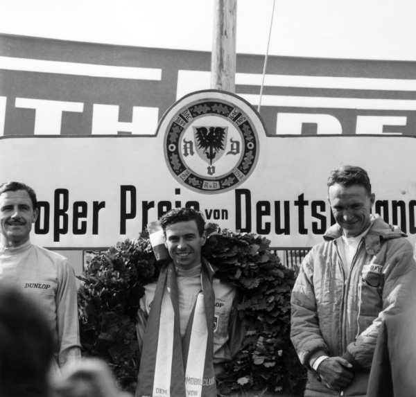 1965 German Grand Prix.Nurburgring, Germany. 1 August 1965.L to R: Graham Hill, BRM P261, 2nd position, Jim Clark, Lotus 33, 1st position and Dan Gurney, Brabham BT11, 3rd position, podium.World Copyright: LAT PhotographicRef: 30398