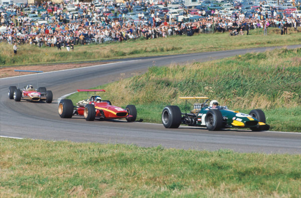 1968 International Gold Cup.  Oulton Park, England. 17th August 1968.  Jack Brabham, Brabham BT26 Repco, leads Jacky Ickx, Ferrari 312, and Jackie Oliver, Lotus 49B Ford, at Cascades.  Ref: 68GC09. World Copyright: LAT Photographic