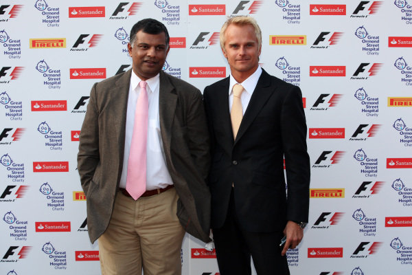Tony Fernandes (MAL) Team Lotus GP Team Principal and Heikki Kovalainen (FIN) Team Lotus. Red Carpet Arrivals, Great Ormond Street F1 Party, Natural History Museum, London, 6 July 2011.