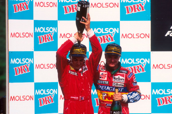 Montreal, Quebec, Canada.9-11 June 1995.Jean Alesi (Ferrari) pours champagne over himself after taking his maiden Grand Prix win. Rubens Barrichello (Jordan Peugeot) 2nd position on the podium.Ref-95 CAN 06.World Copyright - LAT Photographic