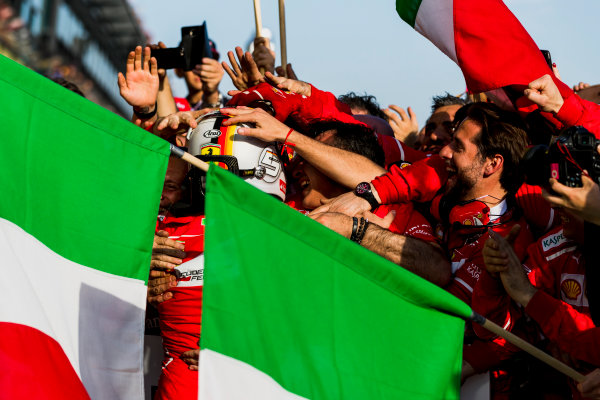 Albert Park, Melbourne, Australia. Sunday 26 March 2017. Sebastian Vettel, Ferrari, 1st Position, celebrates in Parc Ferme with his team. World Copyright: Zak Mauger/LAT Images ref: Digital Image _56I1855