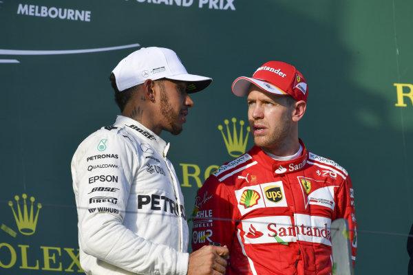 Lewis Hamilton (GBR) Mercedes AMG F1 and Sebastian Vettel (GER) Ferrari on the podium at Formula One World Championship, Rd1, Australian Grand Prix, Race, Albert Park, Melbourne, Australia, Sunday 26 March 2017.