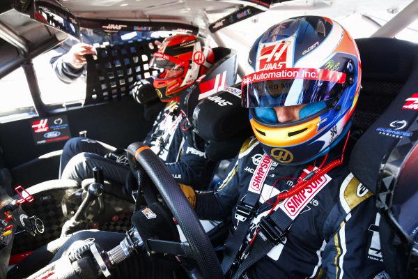 Romain Grosjean, Haas F1, prepares to take Kevin Magnussen, Haas F1 for a ride in a NASCAR