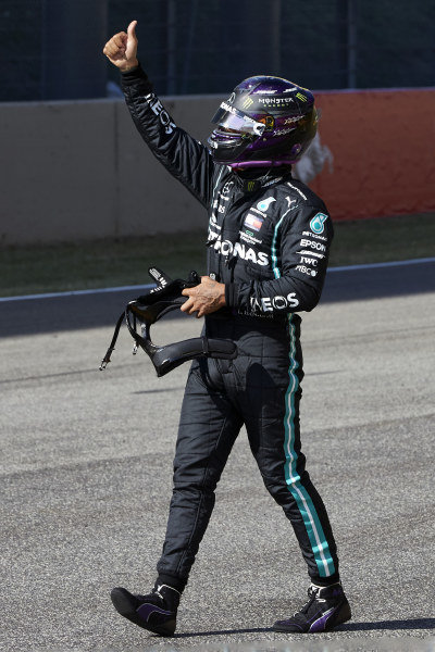 Lewis Hamilton, Mercedes-AMG Petronas F1, celebrates on the grid after securing pole