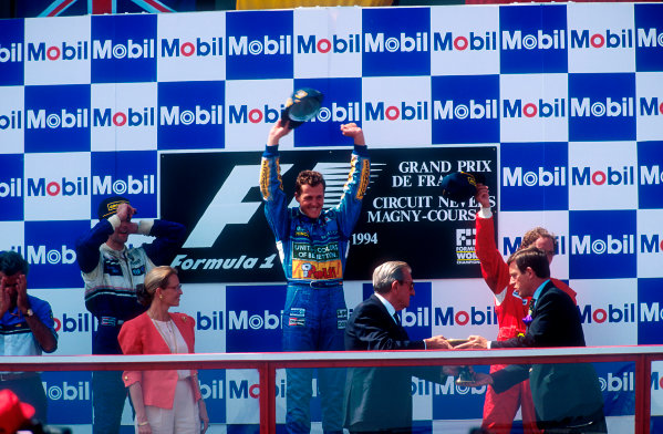 1994 French Grand Prix.Magny-Cours, France.30/6-2/7 1994.Michael Schumacher (Benetton Ford) 1st position, Damon Hill (Williams Renault) 2nd position and Gerhard Berger (Ferrari) 3rd position on the podium. FIA President Jean-Marie Balestre stands in front with Benetton boss Flavio Briatore over on the left hand side. Ref-94 FRA 05.World Copyright - LAT Photographic