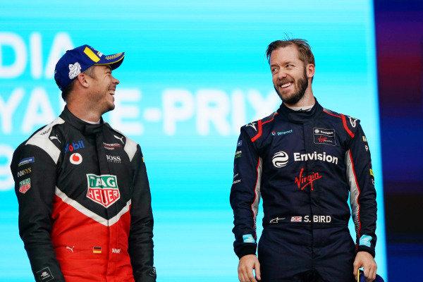 Andre Lotterer (DEU), Tag Heuer Porsche, celebrates on the podium Sam Bird (GBR), Envision Virgin Racing, on the podium