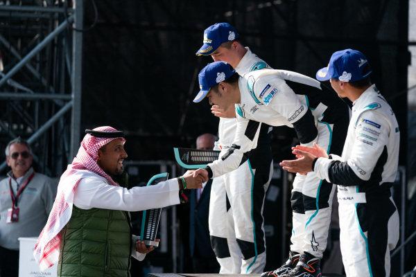 Race winner Zhang Yaqi (CHI), Jaguar China Racing receives his trophy on the podium