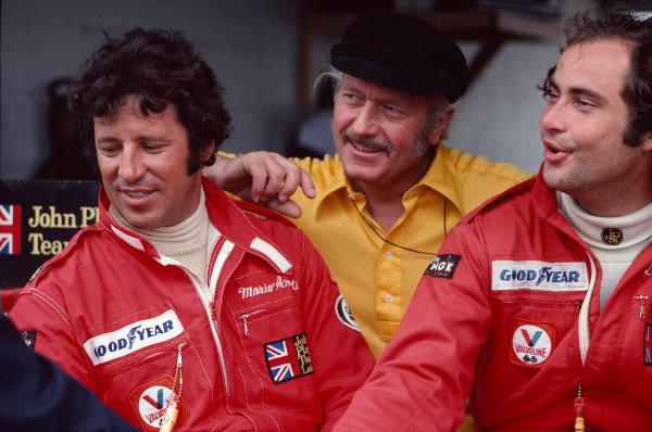 1977 Formula One World Championship.Team boss Colin Chapman with his drivers Mario Andretti and Gunnar Nilsson (Both Lotus Ford).Ref-A2A 08.World Copyright - LAT Photographic