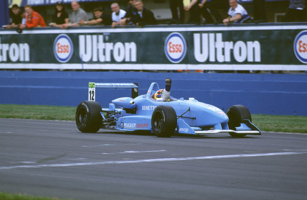 2000 British Formula Three Donington, England. 1st - 2nd July 2000. Rd 7&8. Nicolas Kiesa punches the air as he takes victory in Race 2. World - Peter Spinney/ LAT Photographic