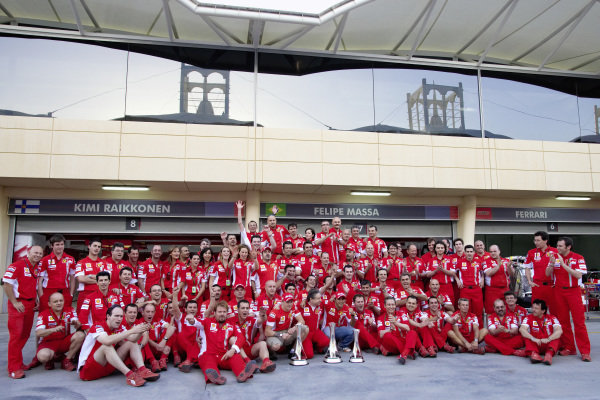 The Ferrari team celebrate a double podium in the pitlane.