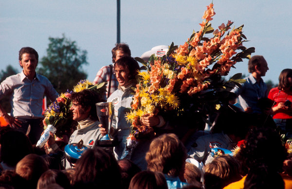 1973 Belgian Grand Prix.Zolder, Belgium.18-20 May 1973.Jackie Stewart (Tyrrell Ford) 1st position, Francois Cevert (Tyrrell Ford) 2nd position and Emerson Fittipaldi (Lotus Ford) 3rd position on the podium.Ref-73 BEL 05.World Copyright - LAT Photographic