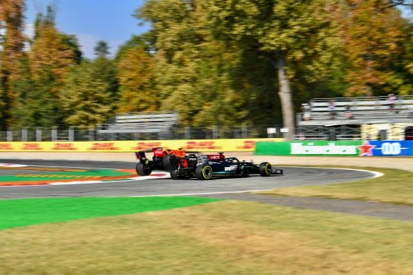 Sir Lewis Hamilton, Mercedes W12 and Max Verstappen, Red Bull Racing RB16B collide at the first chicane