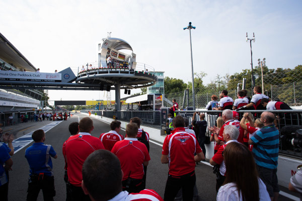 2014 GP3 Series. Round 7.   Autodromo di Monza, Monza, Italy. Sunday 7 September 2014. Some of the Marussia F1 team watch the podium. Dean Stoneman (GBR, Marussia Manor Racing). Photo: Zak Mauger/GP3 Series Media Service. ref: Digital Image _L0U0138