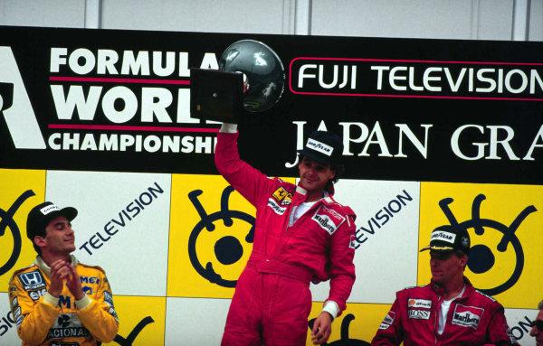 Suzuka, Japan.29/10-1/11 1987.Gerhard Berger (Ferrari), Ayrton Senna (Team Lotus) and Stefan Johansson (McLaren TAG Porsche) celebrate finishing in 1st, 2nd and 3rd positions respectively.World Copyright - LAT Photographic