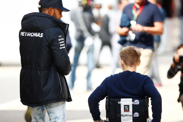 Silverstone, Northamptonshire, UK.  Friday 14 July 2017. njured British F4 racer Billy Monger with Lewis Hamilton, Mercedes AMG. World Copyright: Andy Hone/LAT Images  ref: Digital Image _ONZ5231