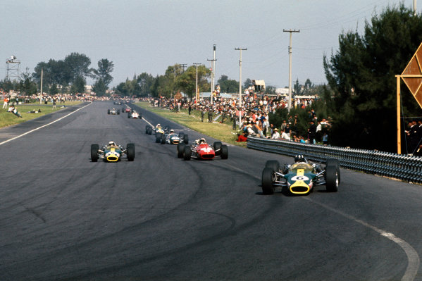 Mexico City, Mexico. 20 - 22 October 1967. Graham Hill (Lotus 49-Ford), retired, leads Jim Clark (Lotus 49-Ford), 1st position, passing Chris Amon (Ferrari 312), 9th position, action.  World Copyright: LAT Photographic. Ref: 67MEX12