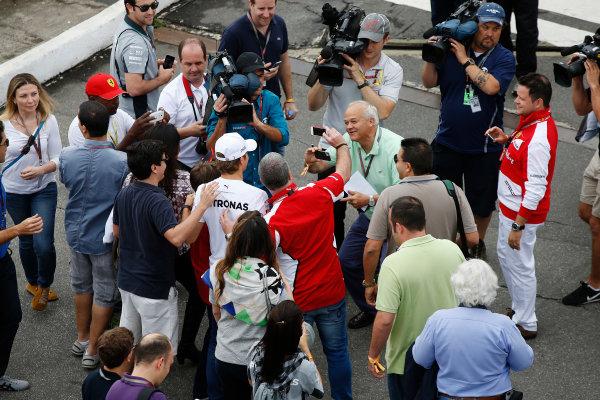 Interlagos, Sao Paulo, Brazil. Sunday 9 November 2014. Nico Rosberg, Mercedes AMG, poses for photos with fans. World Copyright: Charles Coates/LAT Photographic. ref: Digital Image _J5R5223