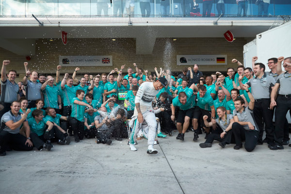 Circuit of the Americas, Austin, Texas, United States of America. Sunday 2 November 2014. Lewis Hamilton, Mercedes AMG celebrates with the team and Nico Rosberg, Mercedes AMG after winning the race. World Copyright: Steve Etherington/LAT Photographic. ref: Digital Image SNE25060