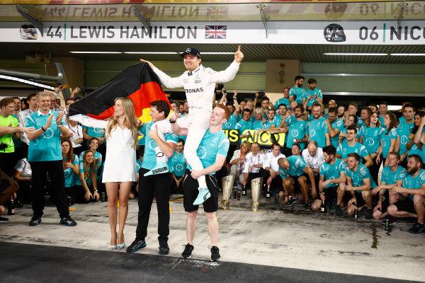 Yas Marina Circuit, Abu Dhabi, United Arab Emirates. Sunday 27 November 2016. Nico Rosberg, Mercedes AMG, 2nd Position and new World Champion, celebrates with his team, friends and family. World Copyright: Andrew Hone/LAT Photographic ref: Digital Image _ONZ0809