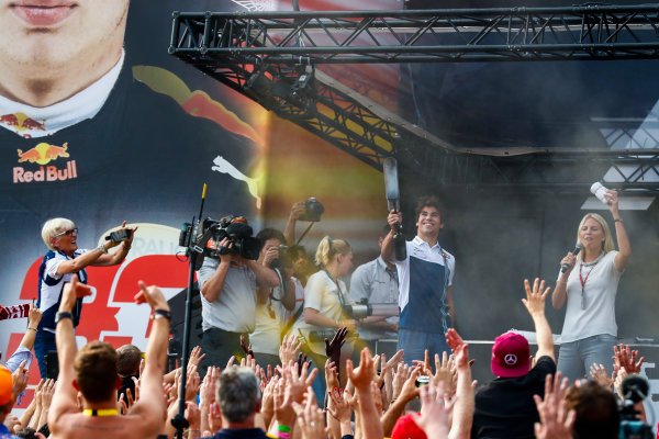 Spa Francorchamps, Belgium.  Saturday 26 August 2017. Lance Stroll, Williams Martini Racing, on stage with a t-shirt cannon in the F1 Fanzone. World Copyright: Sam Bloxham/LAT Images  ref: Digital Image _J6I9205