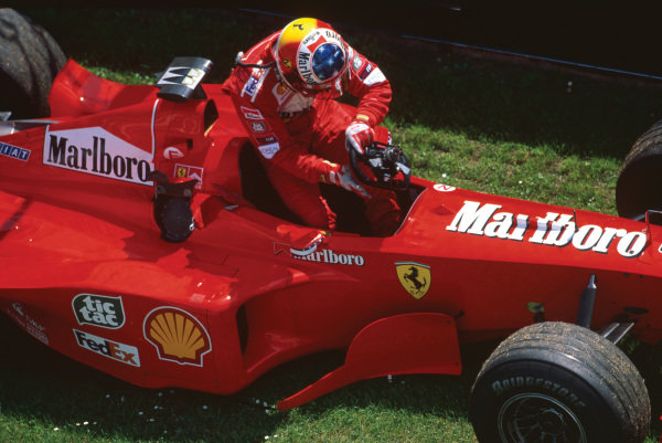 Imola, Italy. .30/4-2/5 1999. Michael Schumacher (Ferrari F399), 1st position, cimbs out of his car during testing, portrait.  World Copyright: LAT Photographic. Ref:  99 SM 84.