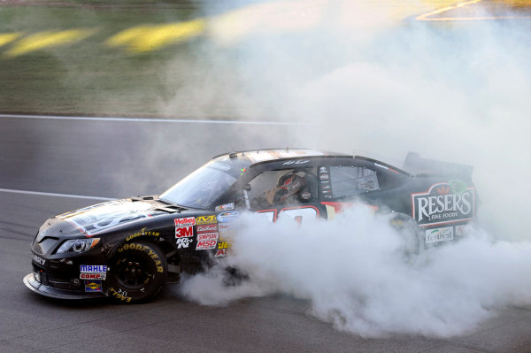 4-5 October, 2013, Kansas City, Kansas USA Matt Kenseth, Resers Toyota Camry celebrates his win with a burnout ©2013, Nigel Kinrade LAT Photo USA