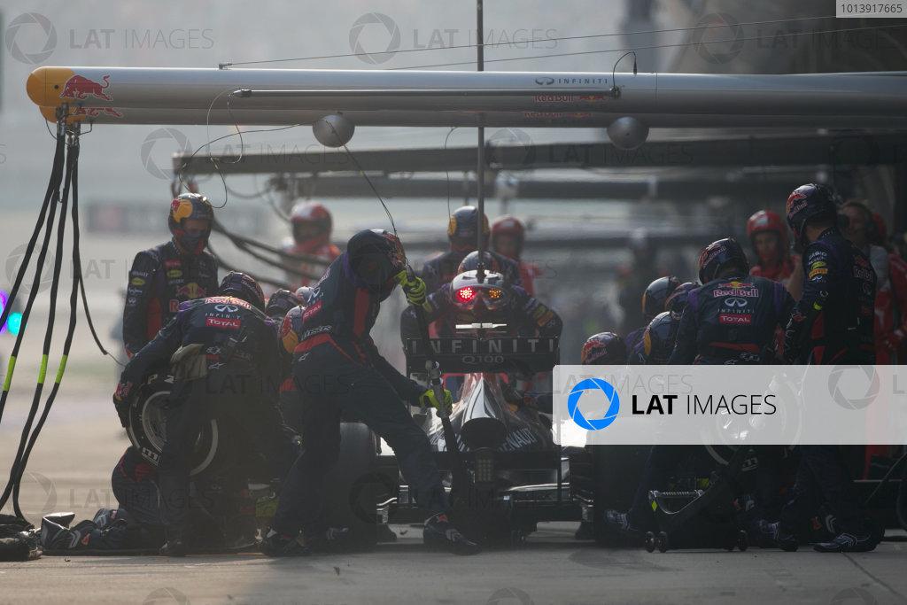 Shanghai International Circuit, Shanghai, China Sunday 14th April 2013 Sebastian Vettel, Red Bull RB9 Renault, makes a pit stop. World Copyright: Andy Hone/LAT Photographic ref: Digital Image HONZ7268