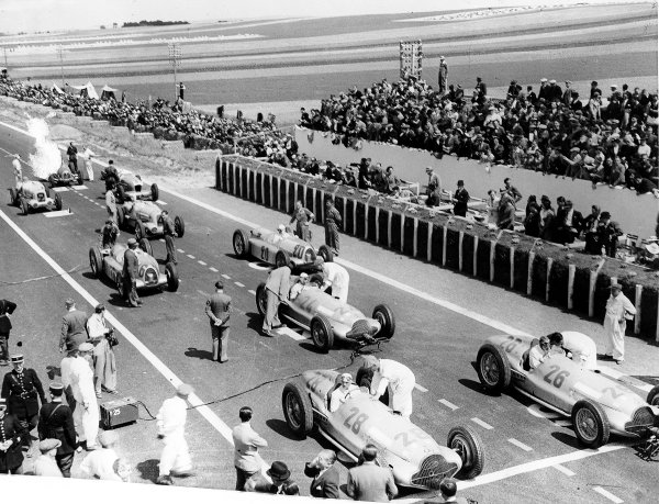 Reims-Gueux, France.3 July 1938.Manfred von Brauchitsch (number 26), Hermann Lang (28), Rudolf Caracciola (24, all Mercedes-Benz W154), Rudolf Hasse (20), Christian Kautz (16, both Auto Union D-typ), Rene Carriere (Lago-Talbot T26SS), Eugene Chaboud (SEFAC), Philippe Etancelin (Lago-Talbot T26SS) and Jean-Pierre Wimille (Bugatti T59) on the grid before the start. Von Brauchitsch finished in 1st position.Published-Autocar 8/7/1938 p76-77.World Copyright - LAT Photographic