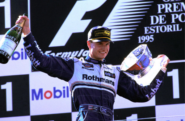 David Coulthard (GBR) Williams, celebrates his first GP win on the podium. Formula One World Championship, Rd13, Portuguese Grand Prix, Estoril, Portugal. 24 September 1995.