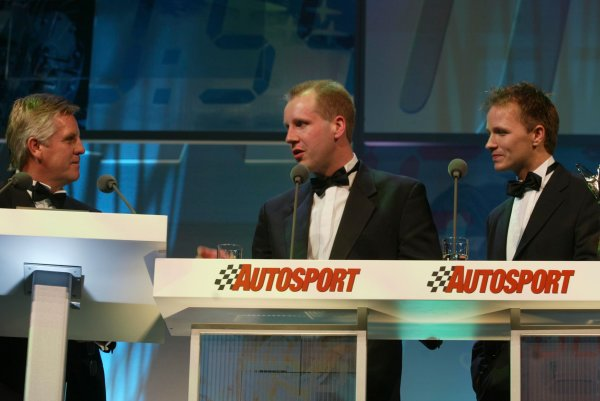 2003 AUTOSPORT AWARDS, The Grosvenor, London. 7th December 2003.Robert Reid and Petter Solberg relay their year to compere, Steve Rider.Photo: Peter Spinney/LAT PhotographicRef: Digital Image only