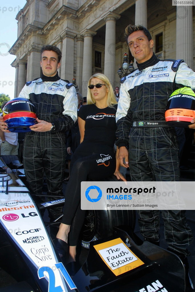 Fernando Alonso (left) and Tarso Marques (right) pose with the new European Minardi PS01.