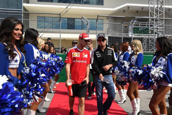 Sebastian Vettel (GER) Ferrari and Sergio Perez (MEX) Force India on the drivers parade at Formula One World Championship, Rd18, United States Grand Prix, Race, Circuit of the Americas, Austin, Texas, USA, Sunday 23 October 2016.