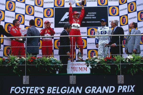 2002 Belgian Grand Prix.Spa-Francorchamps, Belgium. 30/8-1/9 2002.Michael Schumacher (Ferrari) celebrates his 1st position and record 10th Grand Prix win in a season. Rubens Barrichello (Ferrari) 2nd position and Juan-Pablo Montoya (Williams BMW) 3rd position on the podium. Ferrari technical director Ross Brawn stands on the left.Ref-02 BEL 09.World Copyright - BellancaLAT Photographic