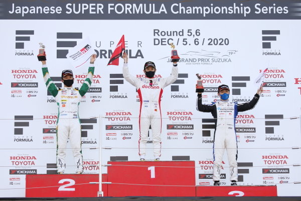 The round five podium. Winner Naoki Yamamoto ( #5 DOCOMO TEAM DANDELION RACING ), Dallara SF19 Honda,  celebrates with Kazuki Nakajima ( #36 VANTELIN TEAM TOM'S ) Dallara SF19 Toyota, 2nd, and Yuji Kunimoto ( #18 carrozzeria Team KCMG ), Dallara SF19 Toyota, 3rd. Photo: Yukio Yoshimi