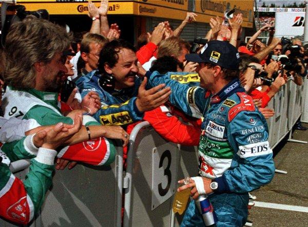 1997 German Grand Prix.Hockenheim, Germany.25-27 July 1997Gerhard Berger (Benetton Renault) is congratulated by Joan Vilderprat after winning at Hockenheim.World Copyright - LAT Photographic
