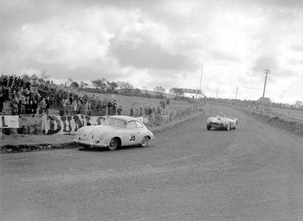 Dundrod, Northern Ireland. 11 September 1954.Raymond Flower/Ernest T McMillen (Porsche 550) leads Alberto Ascari/Luigi Villoresi (Lancia D25).Ref-Motor 774/54.World Copyright - LAT Photographic