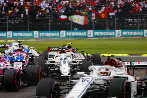 Marcus Ericsson, Alfa Romeo Sauber C37, and Esteban Ocon, Racing Point Force India VJM11, collide on the first lap