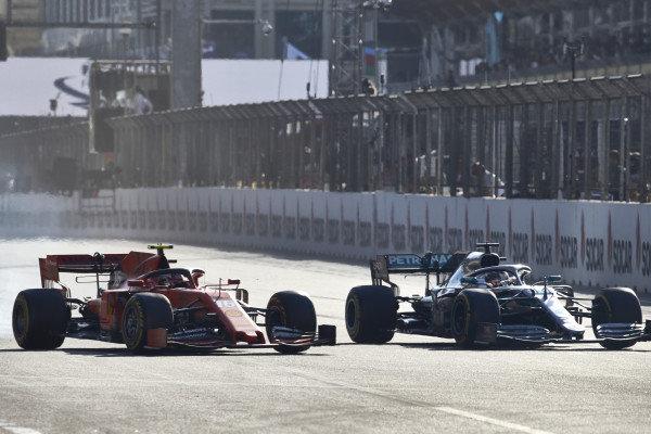 Lewis Hamilton, Mercedes AMG F1 W10,battles withCharles Leclerc, Ferrari SF90