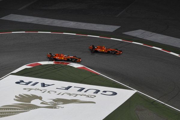 Charles Leclerc, Ferrari SF90 overtakes Sebastian Vettel, Ferrari SF90 for the lead of the race