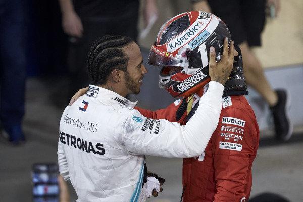 Lewis Hamilton, Mercedes AMG F1, celebrates victory in parc ferme with Charles Leclerc, Ferrari