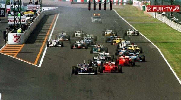 1997 Japanese Grand Prix.Suzuka, Japan.10-12 October 1997.Jacques Villeneuve (Williams FW19 Renault) leads Michael Schumacher (Ferrari F310B) at the start. World Copyright - LAT Photographic