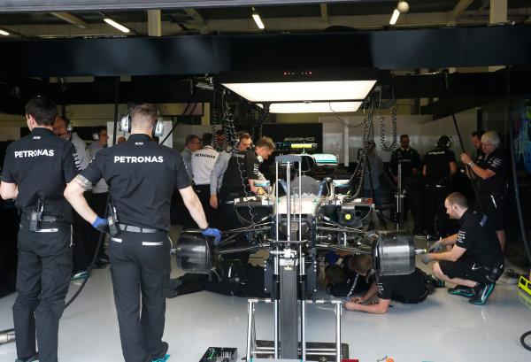 Silverstone, Northamptonshire, UK Friday 08 July 2016. Mercedes team members work on the Mercedes F1 W07 Hybrid of Nico Rosberg. World Copyright: Andrew Ferraro/LAT Photographic ref: Digital Image _FER9702