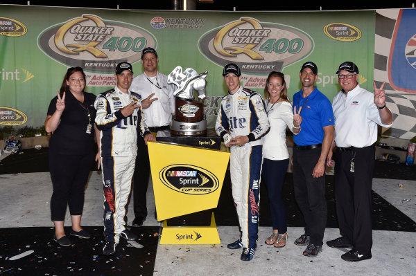 27-28 June, 2014, Sparta, Kentucky USA Brad Keselowski celebrates his win in Victory Lane with Ford guests ?2014, Nigel Kinrade LAT Photo USA