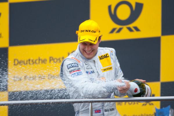 Dijon - Prenois, France. Sunday 11th October. Gary Paffett (Salzgitter AMG Mercedes C-Klasse) celebrates his victory on the podium. World Copyright: Alastair Staley/LAT Photographic.Ref: _O9T0714 jpg