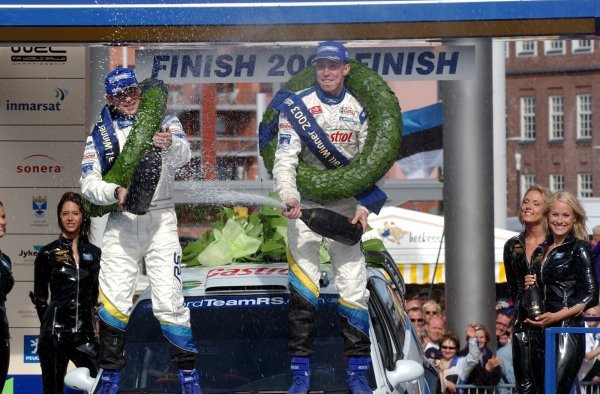 Markko Martin (EST), right, and co-driver Michael Park (GBR), Ford, celebrate their victory on the podium.