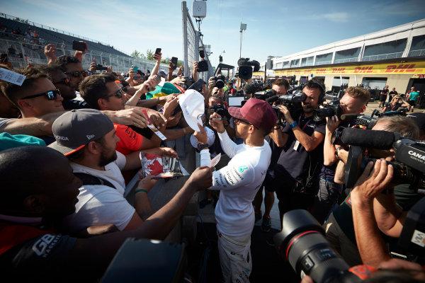 Circuit Gilles Villeneuve, Montreal, Canada. Sunday 11 June 2017. Lewis Hamilton, Mercedes AMG, meets fans and signs autographs. World Copyright: Steve Etherington/LAT Images ref: Digital Imagee SNE10676