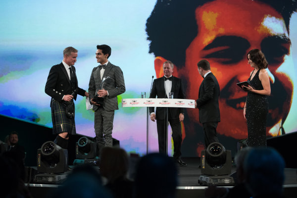 2017 Autosport Awards Grosvenor House Hotel, Park Lane, London. Sunday 3 December 2017. Enaam Ahmed on stage with Christian Horner and Martin Brundle to accept the British Club Driver of the Year Award. World Copyright: Zak Mauger/LAT Images  ref: Digital Image _O3I6595