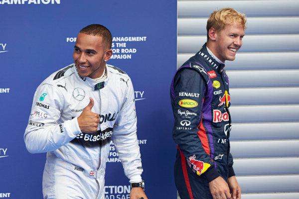 Spa-Francorchamps, Spa, Belgium. 24th August 2013. Front row starters Lewis Hamilton, Mercedes AMG, and Sebastian Vettel, Red Bull Racing. World Copyright: Steve Etherington/LAT Photographic. ref: Digital Image SNE23385 copy.